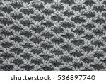 Gray Knitted Cloth Is Made By...