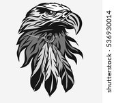 Eagle head with Tribal Feathers, Hawk mascot graphic, Portrait of a bald eagle. Vector