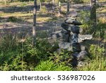 Inukshuk In The Forest