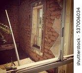 Small photo of Brown Adobe Brick Old House Ruin Broken Window West Texas Desert House