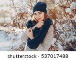 girl walking on snow covered... | Shutterstock . vector #537017488
