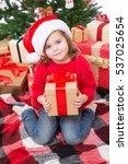 Little Girl In Christmas Box