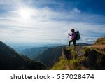young woman hiking stand... | Shutterstock . vector #537028474