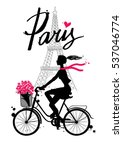 A Girl Rides A Bicycle. Paris....