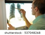 Specialist Watching Image Of...