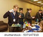 """Small photo of Odessa, Ukraine - December 8, 2016 Business Conference """"Business Strategy 2016"""". Business people in conference room listening to report of coach, teacher on grants. Accreditation Center, reception"""