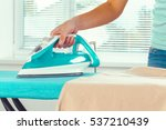 closeup of woman ironing... | Shutterstock . vector #537210439