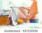 closeup of woman ironing... | Shutterstock . vector #537210556