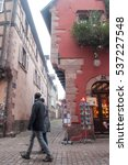 Small photo of KAYSERSBERG - France - 15 December 2016 - tourists in the Street of the the typical alsatian village