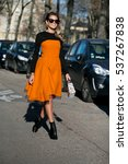 Small photo of PARIS-JANUARY 25, 2016. Helena Bordon is wearing an orange Christian Dior dress on the way to the Christian Dior Fashion show. Haute couture. Paris fashion week.