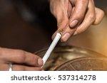 he hand rolled marijuana... | Shutterstock . vector #537314278