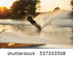 Man Riding Wakeboard In A Lake...
