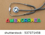 Small photo of Amenorrhea colorful word on the brown background with stethoscope