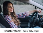 Stock photo young cute brunette driving a car 537437653