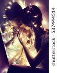 girl near the mirror.  she...   Shutterstock . vector #537444514