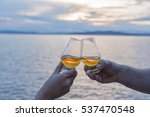 toasting couple at sunset | Shutterstock . vector #537470548
