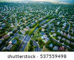 Small photo of Thousands of houses aerial birds eye view suburb housing development new neighborhood in Austin , Texas , USA modern architecture and design
