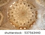 Small photo of GRANADA, SPAIN - November 25, 2016: detail of interior of Alhambra. Muqarnas ceiling decoration and arabesques.