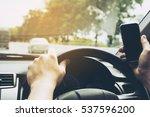 close up of a man driving car... | Shutterstock . vector #537596200