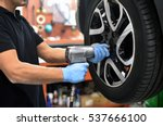 mechanic changing a car tire in ... | Shutterstock . vector #537666100