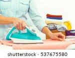 closeup of woman ironing... | Shutterstock . vector #537675580