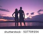 Couple Enjoying On The Beach I...