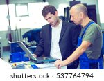 in the factory   boss and... | Shutterstock . vector #537764794