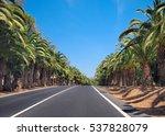Straight Asphalt Road Through...