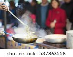 chef cooks pasta in a outdoor... | Shutterstock . vector #537868558