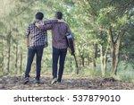 Two Men  Friends Walking On...