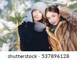 two beautiful girls in a snowy...   Shutterstock . vector #537896128
