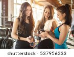 three young girls looking at... | Shutterstock . vector #537956233