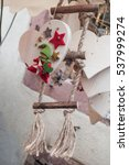 Small photo of closeup of wooden alsatian heart for christmas decorations in the street