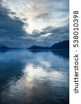 Small photo of Clouds are reflected in water in the fjords of Alaska. Alaska. USA. An excellent illustration.
