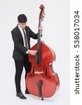 Small photo of The musician playing Double Bass isolated on white background (Artist / young performer)