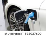 charging an electric car ... | Shutterstock . vector #538027600