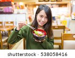 woman eating tuna don in... | Shutterstock . vector #538058416