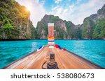 Long Boat And Blue Water At...