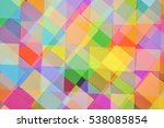 Small photo of Multiple exposure photograph of pieces of colored paper, overlapping and creating an unusual pattern.