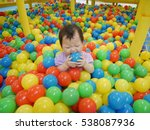 Baby Playing In The Ball Pool