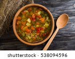 vegetable soup in a wooden... | Shutterstock . vector #538094596