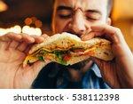 man in a restaurant eating a... | Shutterstock . vector #538112398