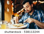 handsome young man having lunch ... | Shutterstock . vector #538113244