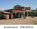 Small photo of NAIROBI, KENYA - June 08, 2009: Street view of a poor suburb in Nairobi, with colorful local stores selling different things
