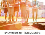 sportsmen running at stadium | Shutterstock . vector #538206598