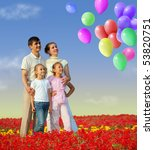 Family Of Four In Red Field An...
