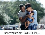 happy parents with a baby | Shutterstock . vector #538314430