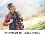 hiker with backpack walking in... | Shutterstock . vector #538339588
