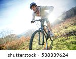 Mature Man Riding Bike In The...