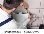 plumber repairing toilet... | Shutterstock . vector #538339993